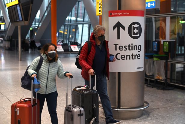 A sign directs passengers to a Covid-19 testing centre at Terminal 5 of London Heathrow Airport