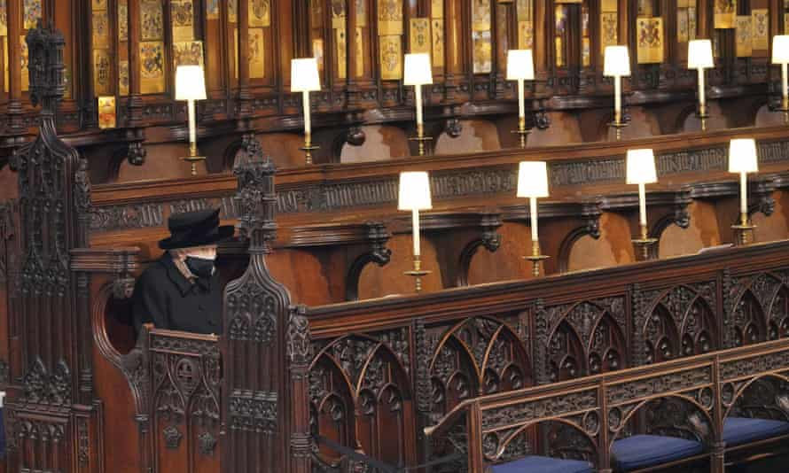 The Queen sits alone in St George's Chapel during the funeral of Prince Philip, the man who had been by her side for 73 years.