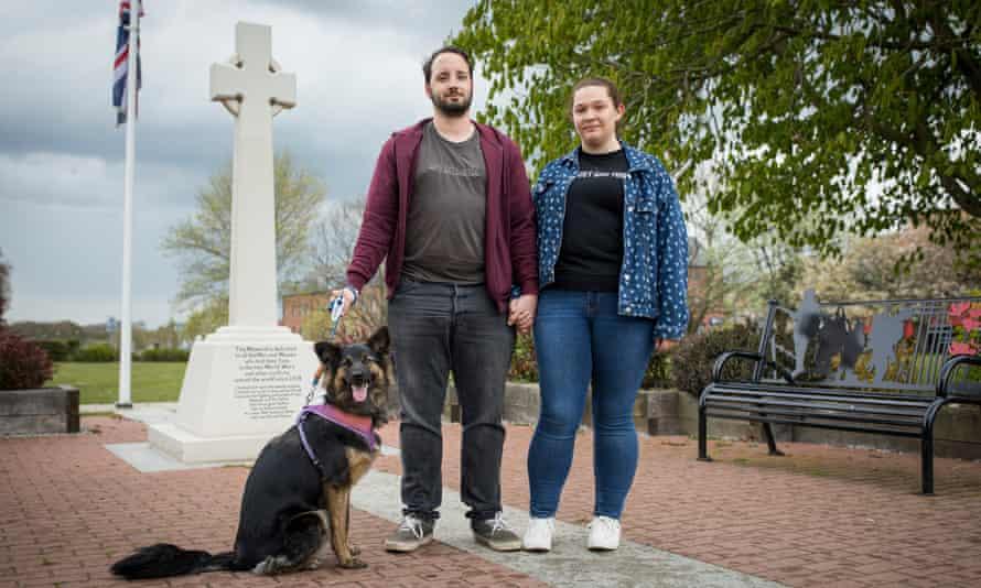 Sam and Kira Mandon-Jones with their dog Mocha in Market Place, Aylesham, Kent.