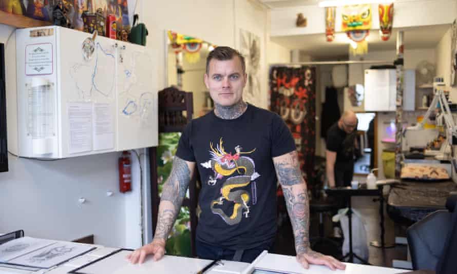 Tattooist Stewart Ferguson in his tattoo parlour in north London.