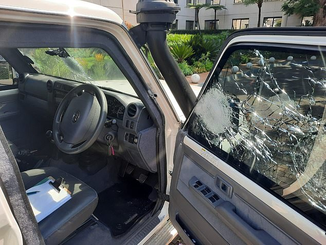 A dozen shots at least are first heard as one car pulls alongside security expert Leo on the N4 motorway in capital Pretoria. The targeted vehicle is pictured, above and below