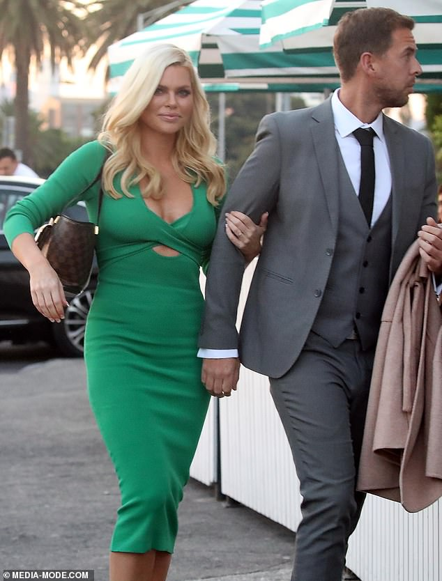Making them green with envy!Sophie dressed for the nines for the occasion, sporting a plunging emerald pencil dress that clung to her figure in all the right places