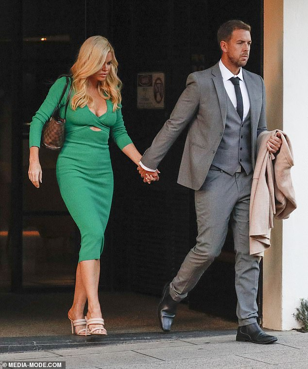 Putting on the ritz! Looking every inch the glamour couple, the duo arrived at an upmarket restaurant in a chauffeur-driven car before making their way to the entrance hand in hand