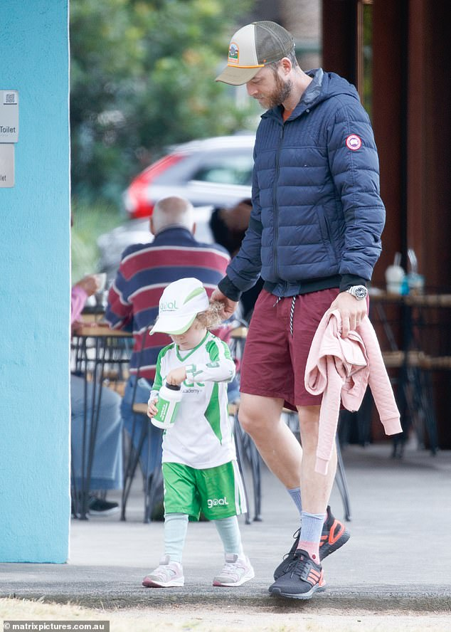 Daddy cool:Hamish dressed casually in red shorts, a matching T-shirt and a navy puffer jacket