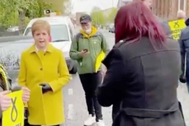 The First Minister told the far-right candidate that she was a 'fascist and a racist'