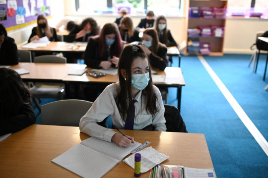 Year 9 students take part in a class at Park Lane Academy in Halifax, northwest England on March 17, 2021. (Photo by Oli SCARFF / AFP) (Photo by OLI SCARFF/AFP via Getty Images)