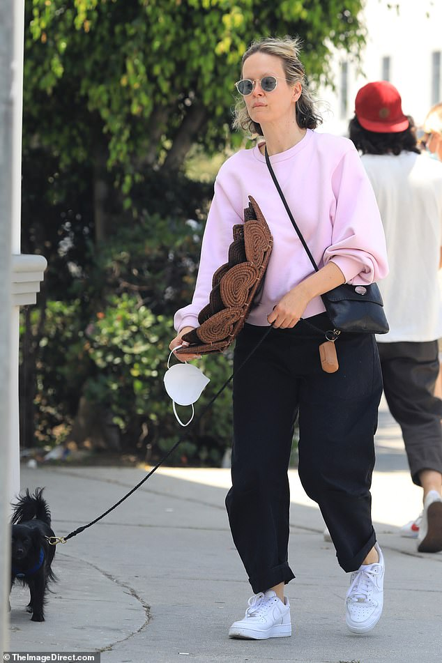 Puppy love: The actress, 44, was seen with a female pal as she walked her rescue dog Winnie, who she shares with girlfriend Holland Taylor, 78, amid widespread discussion over her 'weight gain'