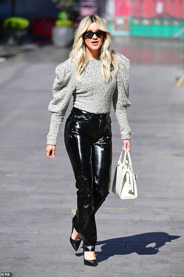 Golden girl:The former Pussycat Doll, 39 set pulses racing as she stepped out in PVC trousers and pointy black stilettos on her walk home