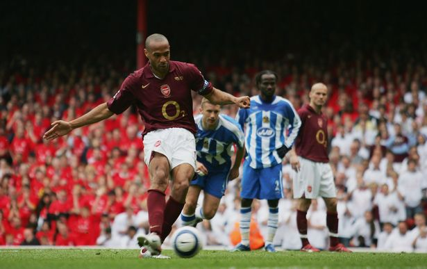 Thierry Henry helped Arsenal record a win over Wigan which sealed fourth place at the expense of Spurs