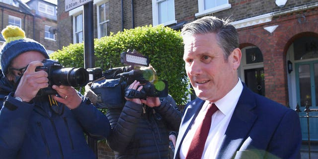 Britain's opposition Labour Party leader Keir Starmer leaves his home in London on May 7, 2021, following the declaration that the Labour Party has lost the Hartlepool parliamentary election. (Stefan Rousseau/PA via AP)