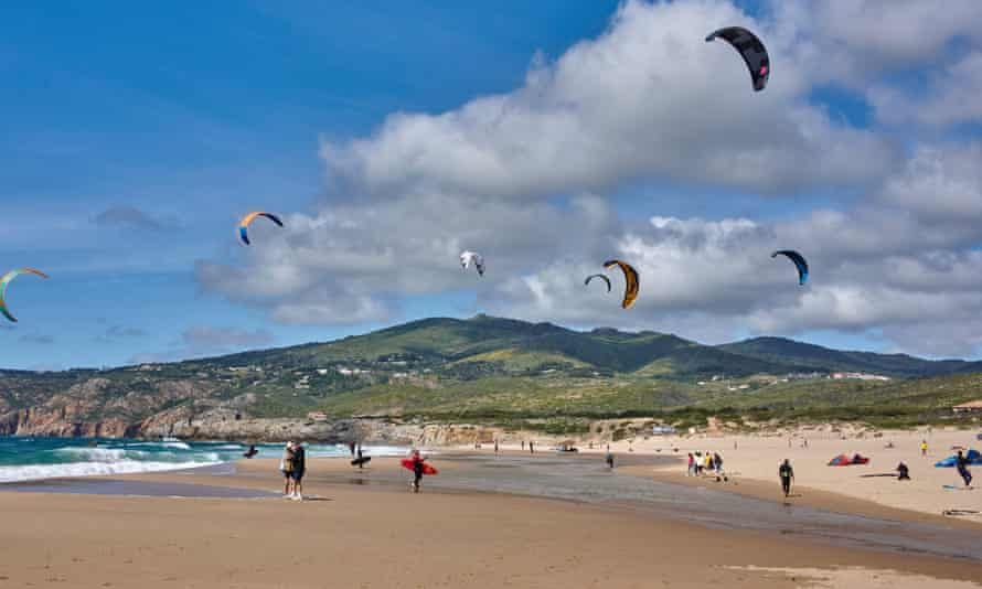 Kite surfers practise in Praia do Guincho, Portugal