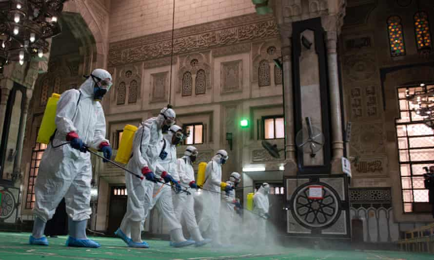 Workers disinfecting the al-Fateh mosque in Cairo