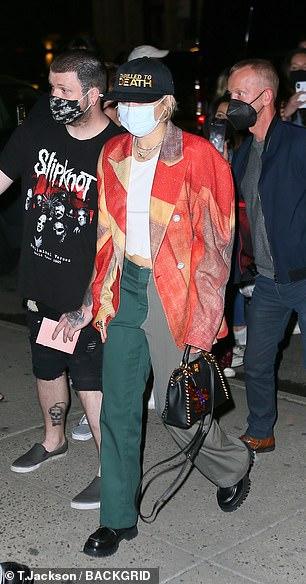 Trendy: The star carried a sleek black purse
