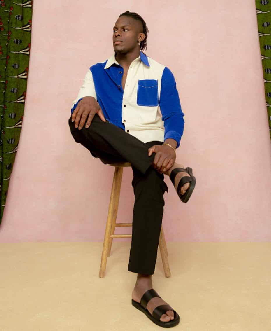 Rugby player Maro Itoje, against pink background with green curtains. April 2021