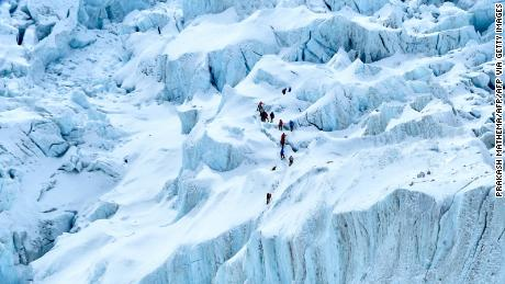 Covid fears are spreading on Mount Everest, as climbers risk infection to reach the top of the world