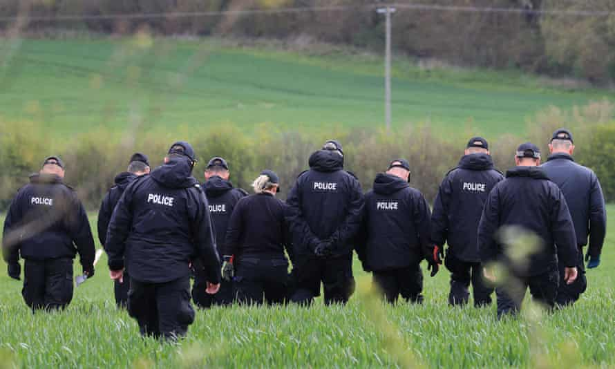 Police officers continue their search of fields close to the hamlet of Snowdown, near Aylesham, East Kent.