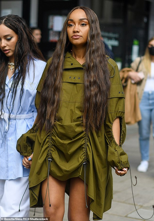 Hiding:Her bump debut comes after she was seen in a series of baggy ensembles in recent weeks, with her last appearance on Friday 30 April in London, where she wore a baggy khaki green outfit which hid her stomach perfectly