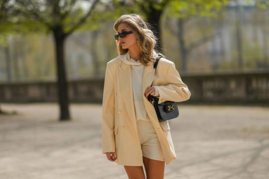 street style: woman wearing beige blazer and shorts