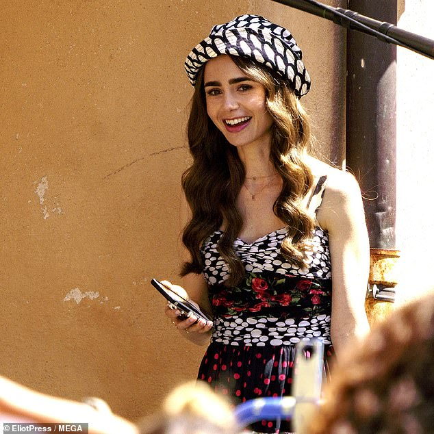 Upbeat: The actress was in high spirits as she idled on the set in Saint Tropez between takes