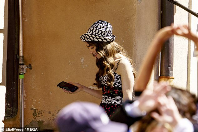 Getting the message: Lily appeared to check her phone while filming season two of the hit show