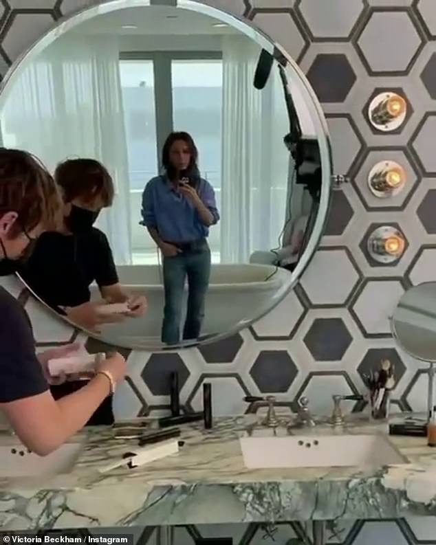 Fun:Sharing a behind-the-scenes clip, where they were joined by Victoria's hairstylist Ken Paves, the group got to work in a bathroom where the former Spice Girl was seen wearing jeans and a shirt