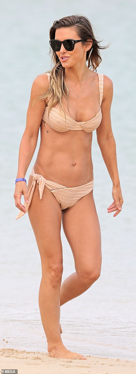 The Los Angeles native showcased her slim 5ft5in figure in a beige-patterned underwire bikini top and bottom featuring a side sash
