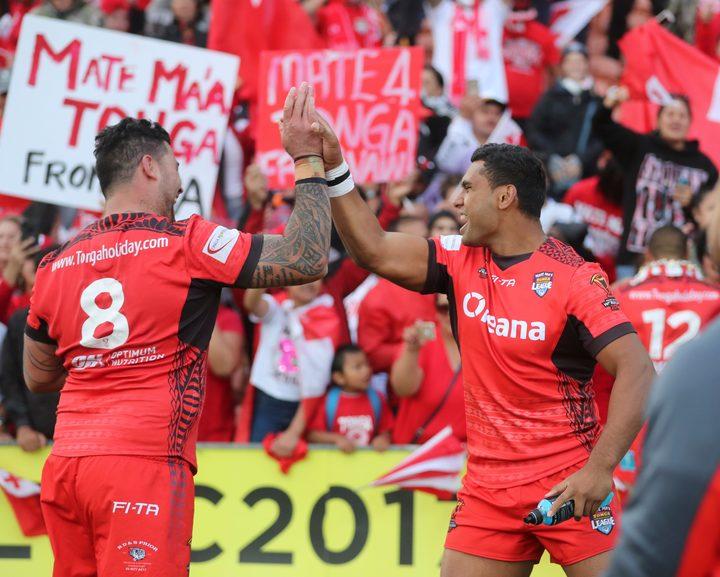 Tonga's Andrew Fifita and Tevita Pangai Junior celebrate their upset win over the Kiwis at the 2017 World Cup.