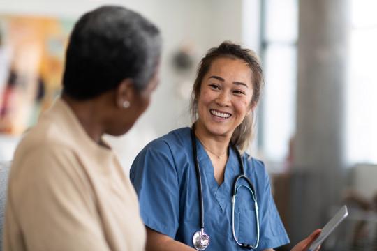 mental health nurse smiles at a patient
