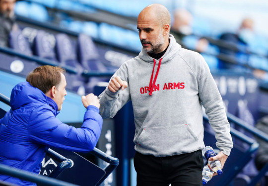Pep Guardiola, manager of Manchester City fist bumps with Thomas Tuchel, manager of Chelsea during the Premier League match between Manchester City and Chelsea at Etihad Stadium on May 08, 2021 in Manchester, England. Sporting stadiums around the UK remain under strict restrictions due to the Coronavirus Pandemic as Government social distancing laws prohibit fans inside venues resulting in games being played behind closed doors.