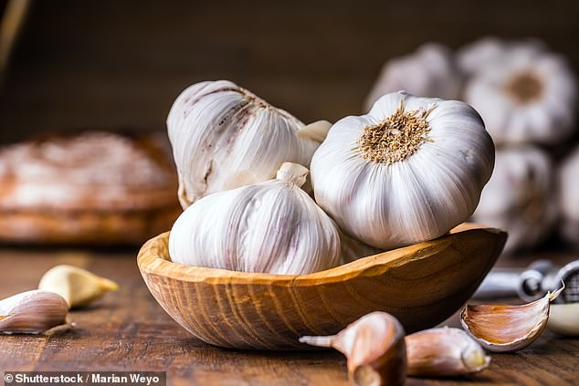 Garlic (pictured), ginger, cinnamon and saffron might help treat rheumatoid arthritis, suggests a study published in the journal Nutrients