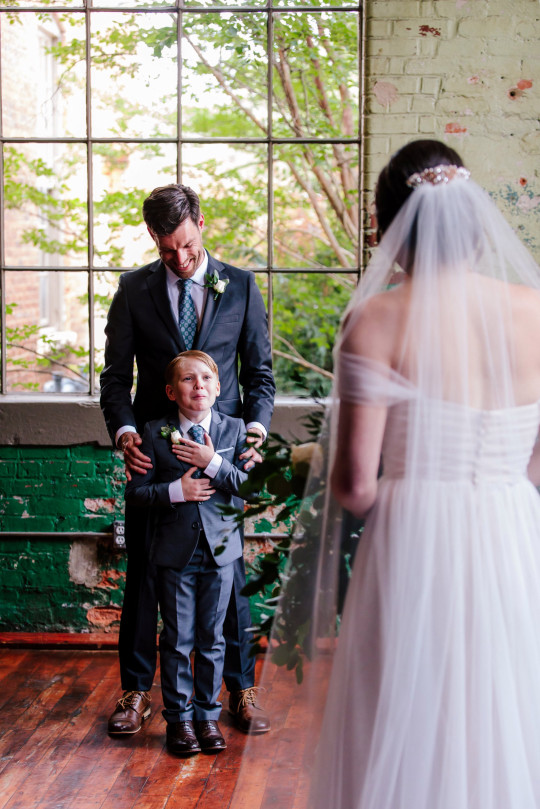 These images show the adorable moment ten-year-old Jude Seabolt burst into tears after seeing his new stepmum Rebekah Seabolt in her wedding dress at her wedding to his father Tyler Seabolt. Monroe, Georgia, USA
