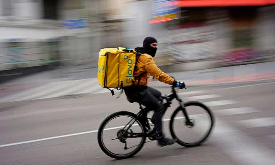 A Glovo food delivery courier in Madrid during the first wave of the pandemic