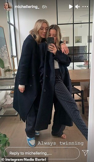 'Always twinning,' she captioned a photo of herself and Nadia wearing the exact same pair of navy blue pinstripe pants and dark coats