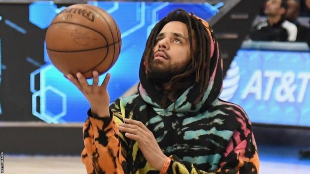 J Cole with basketball