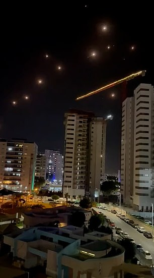 Footage shows dozens of Israeli Iron Dome missiles shooting down bombardment over Tel Aviv