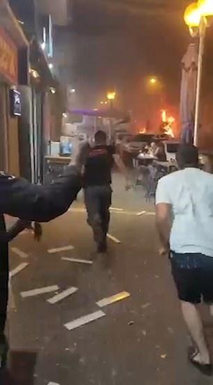 Locals begin running towards the fire