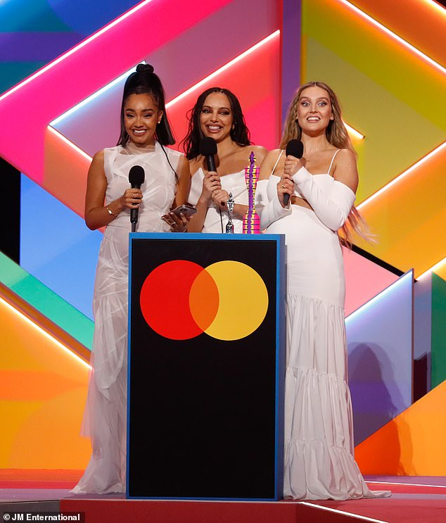 Mixing it up: Jade Thirlwall [centre] dedicated Little Mix's historic British Group BRITs win to the iconic girl bands of the 90s on Tuesday night [pictured withLeigh-Anne Pinnock, L, and Perrie Edwards, R]