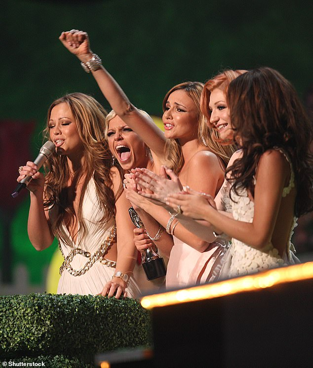 Homage: Little Mix were sure to dedicate the award to the girl bands that came before them, such as Girls Aloud [pictured at the BRITs in 2009]