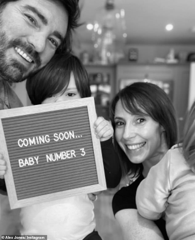 'Coming soon!': She also shared the news to her Instagram as she uploaded a sweet black-and-white photo with her husband and their bots