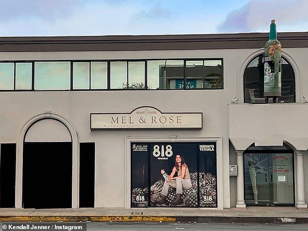 Promo:And in anticipation of the May 17 launch, the 25-year-old supermodel has plastered her image on the front of Mel & Rose liquor store in West Hollywood, California