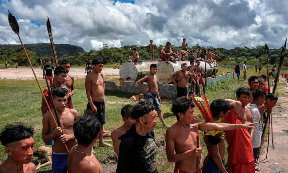 Members of the Yanomami ethnic group wait for Covid-19 tests in the indigenous land of Surucucu, in Alto Alegre, Roraima state, last July.