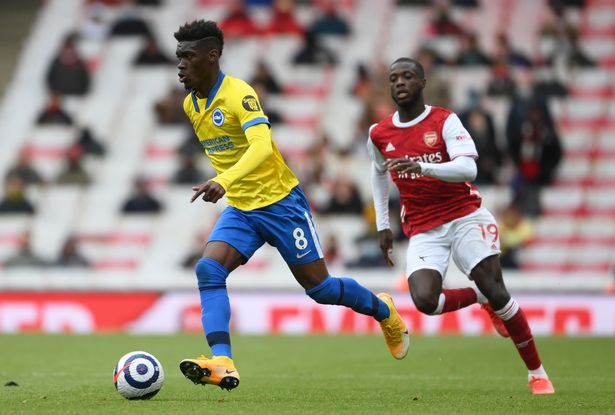 Yves Bissouma of Brighton & Hove Albion is put under pressure by Nicolas Pepe of Arsenal