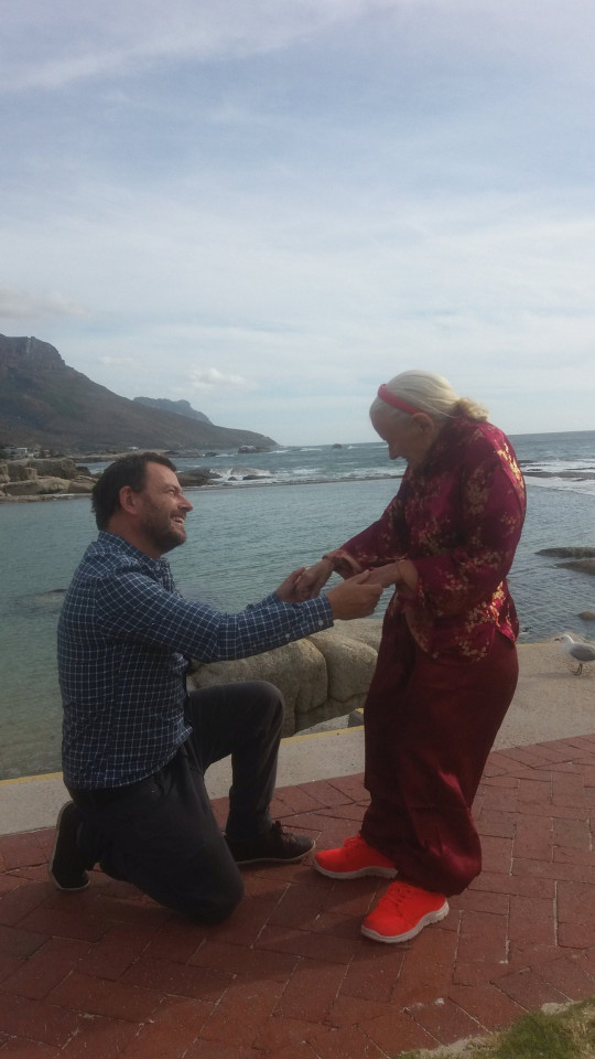 Sean O'Sallaigh and his mother Mary O'Niel in Cape Town on her birthday in 2018. See SWNS story SWTPalzheimer's. A son has described how his mum's Alzheimer's disease improved as he took her travelling across the world in her final years. Sean O'Sallaigh, 44, was a full time carer for his mum, Mary O'Niel, and decided to take her to Nepal to escape the harsh Irish winter. Sean was amazed when Mary, who had Alzheimer's disease, started walking and talking again during their trip. He decided to keep travelling with her until she died in South Africa 18 months later.
