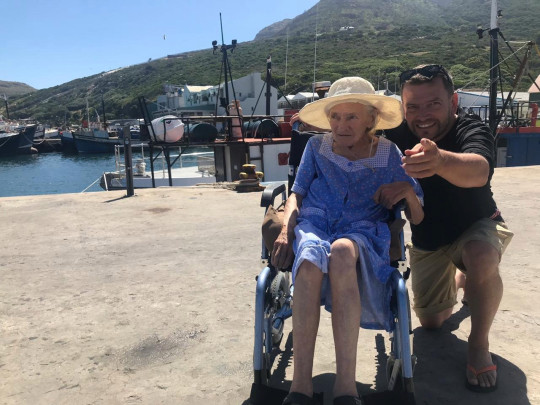 Sean O'Sallaigh and his mother Mary O'Niel in Cape Town. See SWNS story SWTPalzheimer's. A son has described how his mum's Alzheimer's disease improved as he took her travelling across the world in her final years. Sean O'Sallaigh, 44, was a full time carer for his mum, Mary O'Niel, and decided to take her to Nepal to escape the harsh Irish winter. Sean was amazed when Mary, who had Alzheimer's disease, started walking and talking again during their trip. He decided to keep travelling with her until she died in South Africa 18 months later.