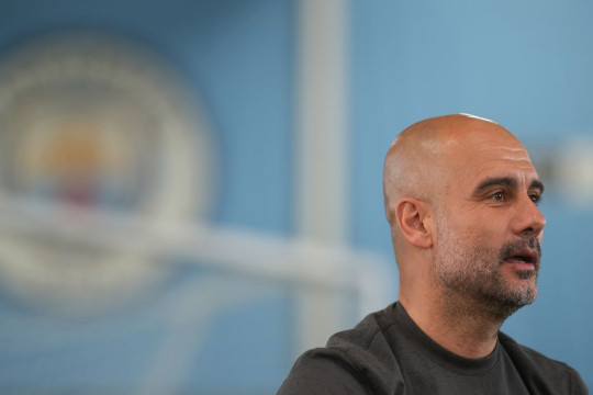Manchester City manager Pep Guardiola looks on