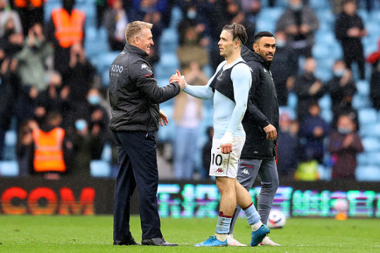 Dean Smith and Jack Grealish shake hands after Aston Villa's clash with Chelsea