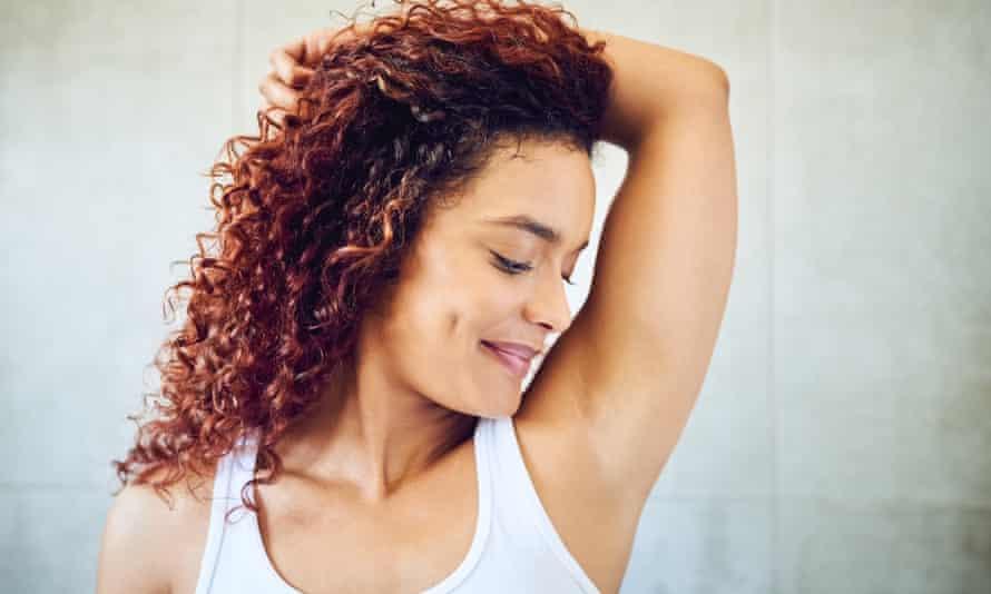 Woman smelling her armpit
