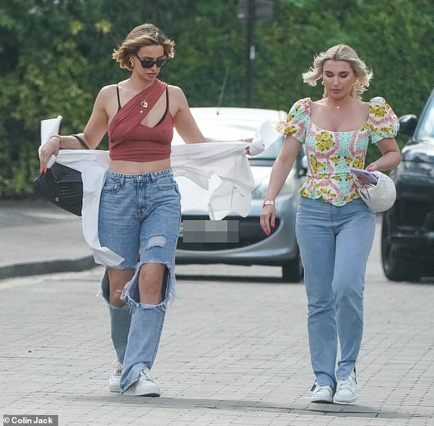 Details: Ferne teamed the item of clothing with a pair of ripped mom jeans and white platform trainers