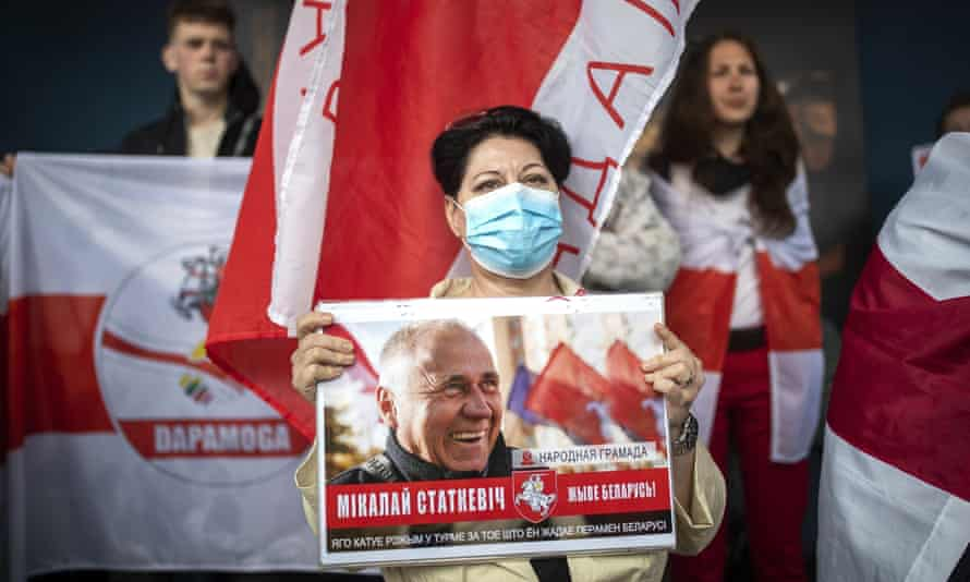 Protesters in Vilnius, Lithuania, hold a poster showing the Belarusian opposition activist Nikolai Statkevich, who was detained while heading for a protest last year