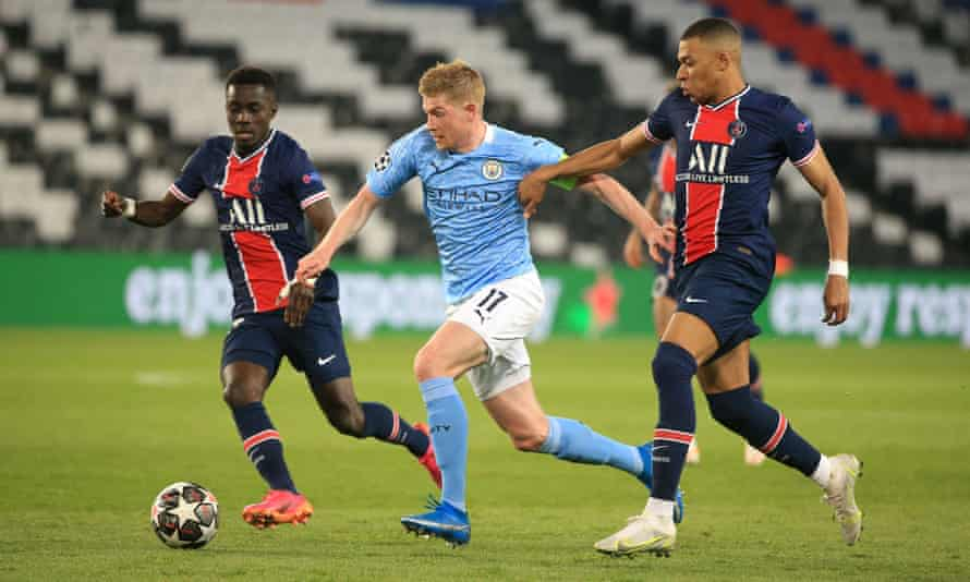 Kevin De Bruyne surges away from Idrissa Gueye and Kylian Mbappé during a masterful Champions League performance at PSG.